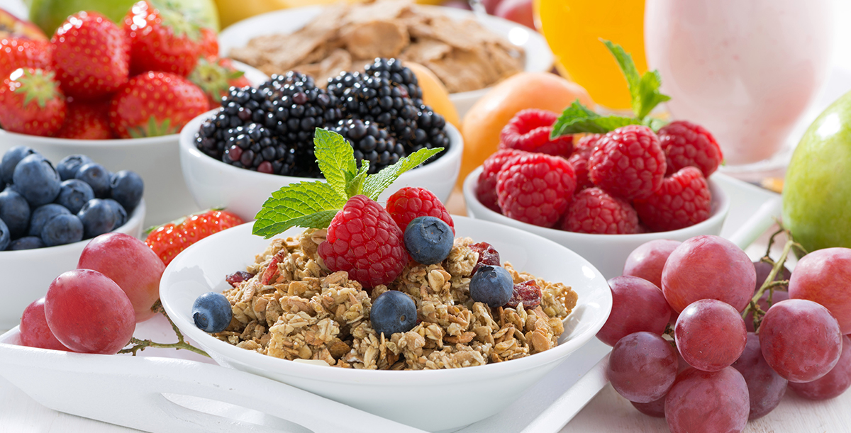 Delicious and healthy breakfast with fruits, berries, cereal