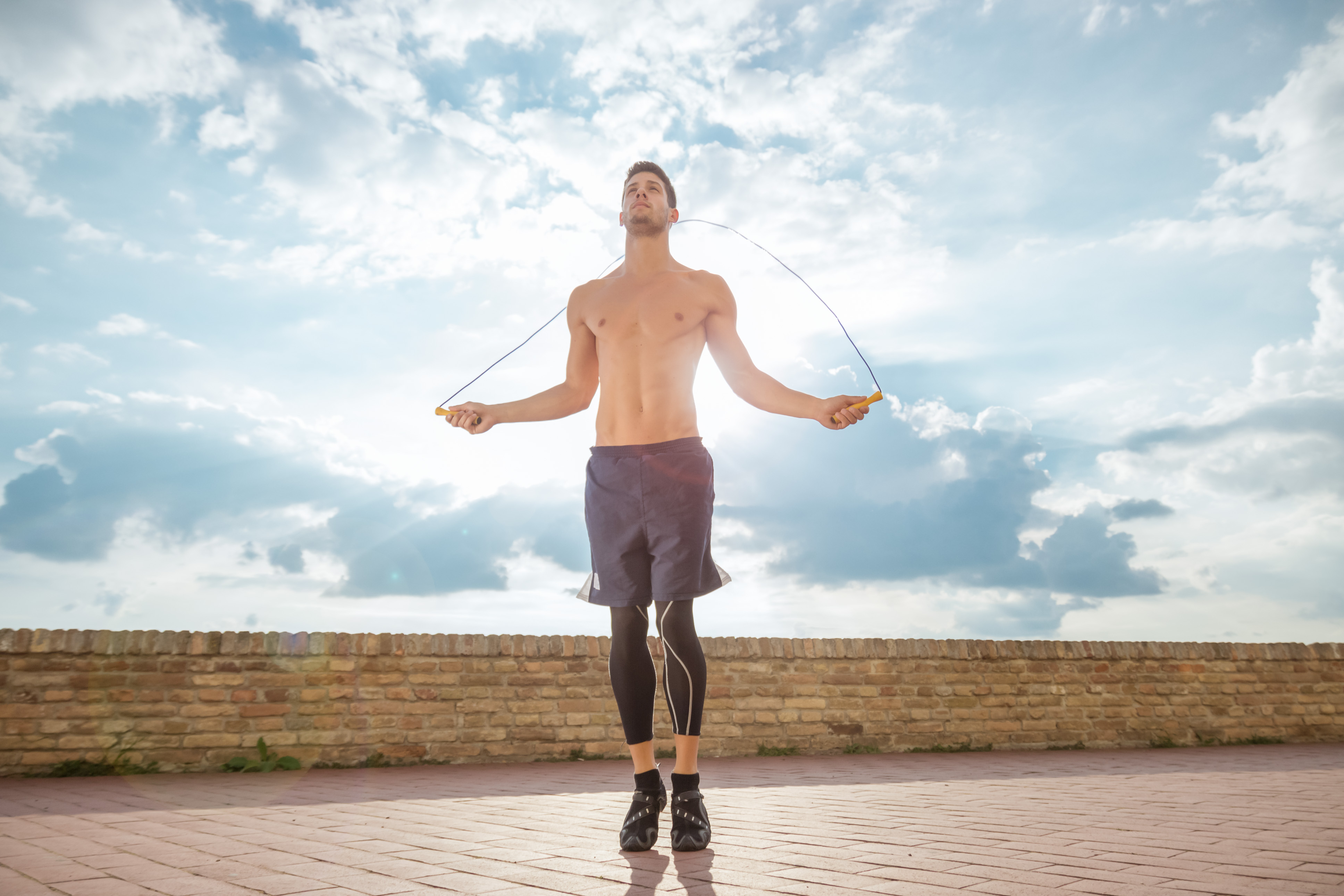 young man jump jumping rope fit slim abs model sunny